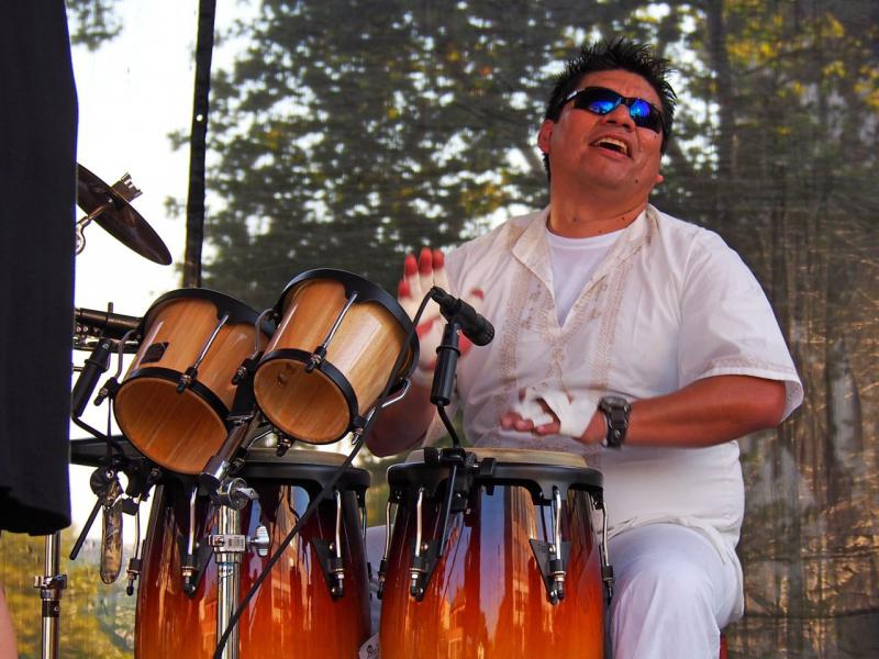 Heber Mena of La Movida enjoys the music in 2013.